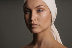 Young woman with head scarf looking away Royalty Free Stock Images