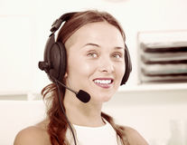 Young woman with head set at office Stock Photo