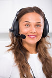 Young woman with head set at office Royalty Free Stock Images