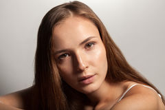 Young woman head shot. Studio head shot portrait of young brunette woman Stock Image