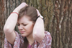 Young woman with headache. Young woman having a headache Royalty Free Stock Photos