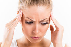 Young woman with a headache Royalty Free Stock Photography