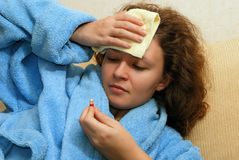 Young woman with headache. Young Europian woman with headache watching at pill stock photos