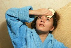 Young woman with headache. Young Europian woman with headache royalty free stock photos