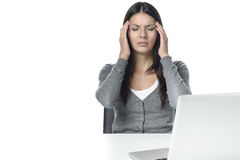 Young Woman with Headache Facing Laptop Stock Photo