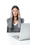 Young Woman with Headache Facing Laptop Stock Image