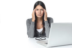 Young Woman with Headache Facing Laptop Royalty Free Stock Images