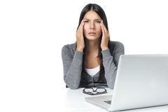 Young Woman with Headache Facing Laptop Stock Photography