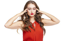 A young woman with a headache holding head, isolated on white ba Royalty Free Stock Image