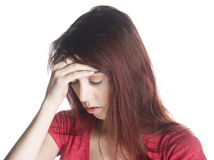 Young Woman with Headache Holding her Forehead Royalty Free Stock Image