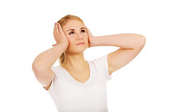 Young woman with headache holding her hand to the head Royalty Free Stock Photo