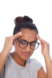Young Woman with Headache Holding her Head. Close up Young Woman Wearing Eyeglasses Holding her Head While Suffering From Headache. Isolated on White Background Stock Photography