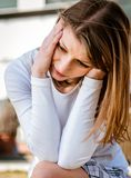 Young woman with headache outdoor Royalty Free Stock Photo