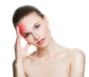 Young Woman with an Headache. Woman Puts Hands on the Head on White Royalty Free Stock Image