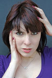 A young woman with headaches Royalty Free Stock Image