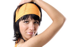 Young woman with headband. Portrait of young black haired woman with yellow headband, isolated on white background Royalty Free Stock Photos