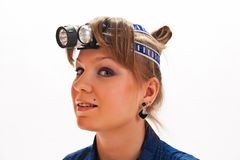 Young woman with headlamp. On head royalty free stock photos
