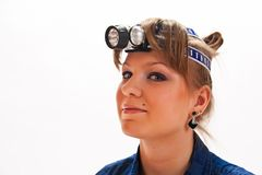 Young woman with headlamp. On head stock photo
