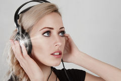 Young woman with headphone Royalty Free Stock Photos