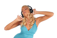 Young woman with headphones. Listening to music Stock Image