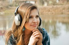 Young woman with headphones Royalty Free Stock Images