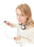 Young woman with headphones Stock Images
