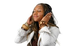 Young Woman With Headphones. Listening sounds over a white background Stock Photography