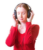 Young woman in headphones. With eyes closed, listening to something, isolated on white Stock Image
