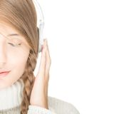 Young woman with headphones. Royalty Free Stock Photography