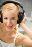 Young woman in headphones Stock Images