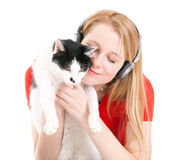 Young woman in headphones with cat Royalty Free Stock Photography