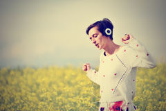 Young woman with headphones dancing in the outdoors Stock Images