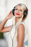 Young woman with headphones. Enjoy the music. Royalty Free Stock Photography