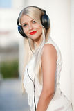 Young woman with headphones. Enjoy the music. Stock Photos