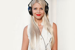 Young woman with headphones. Enjoy the music. Stock Images