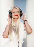 Young woman with headphones. Enjoy the music. Royalty Free Stock Image