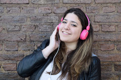 Young woman with headphones. Stock Images