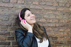 Young woman with headphones. Royalty Free Stock Photos