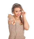 Young woman in headphones listening music Royalty Free Stock Image