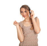Young woman in headphones listening music Stock Photos