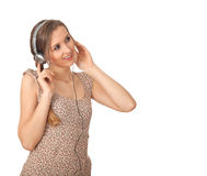 Young woman in headphones listening music Stock Image