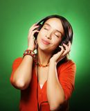 Young  woman with headphones listening music Stock Photography