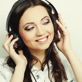 Young woman with headphones listening music Royalty Free Stock Photo