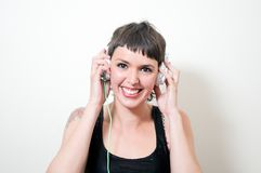 Young woman with headphones listening to the music Royalty Free Stock Images