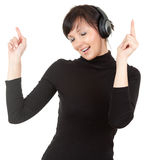 Young woman with headphones listening to music Stock Images