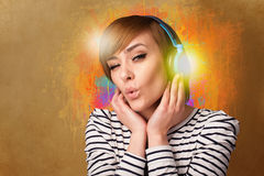 Young woman with headphones listening to music Stock Photography