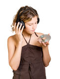 Young woman in headphones listening to music Stock Photography