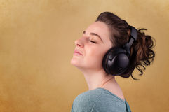 Young woman with headphones listening to music with copy space Royalty Free Stock Image