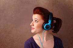 Young woman with headphones listening to music with copy space Royalty Free Stock Photography