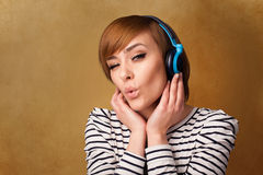 Young woman with headphones listening to music with copy space Royalty Free Stock Photos